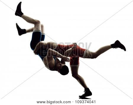 two caucasian wrestlers wrestling men on isolated silhouette white background
