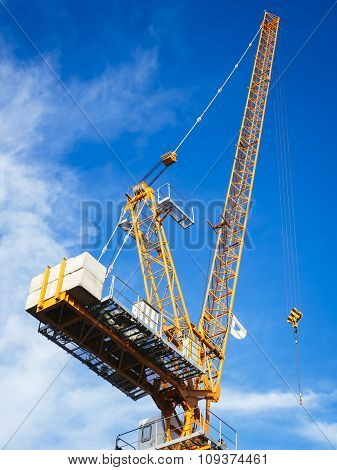 Crane Work In Construction Site With Blue Sky Background
