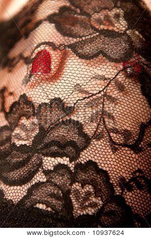 Red Fingernail Under Black Nylon Stockings