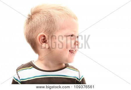 Little boy is smiling and looking left