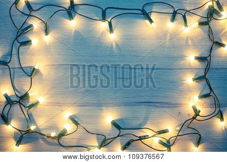 Christmas lights  frame on a wood toned