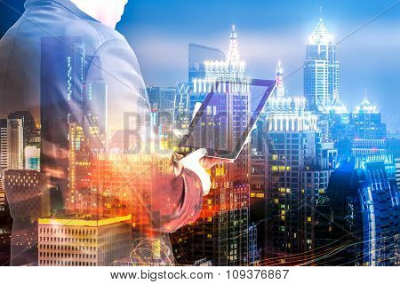 Double Exposure Of Success Businessman Using Digital Tablet With London Building And Social Media Di