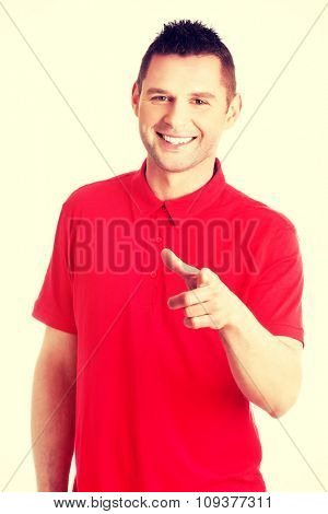 Happy  young man pointing you.