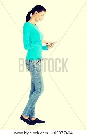 Side view of woman using tablet.