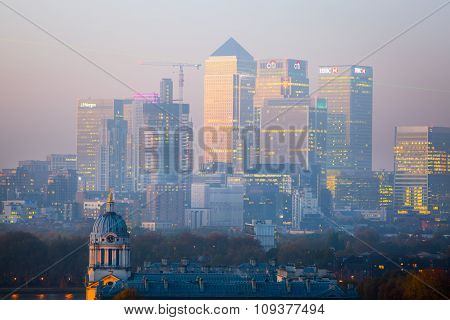 London, UK - October 31, 2015:  Panorama of Canary Wharf in night. View includes the park, Royal cha