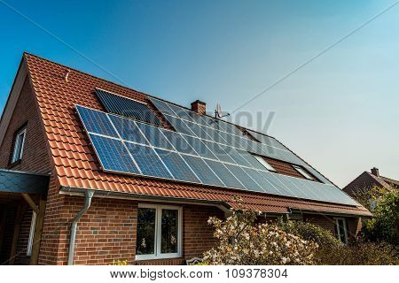 Solar panel on a red roof - alternative energy source