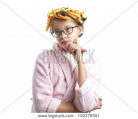 Thoughtful Girl In A Bathrobe And Curlers..