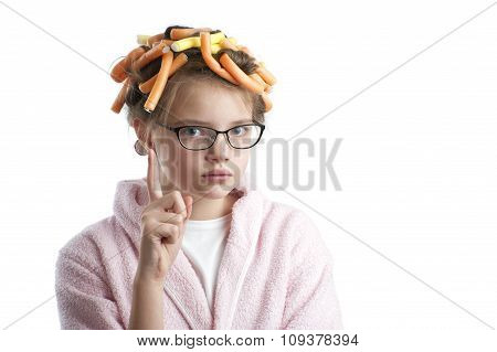 Girl In Curlers And A Bathrobe With A Raised Finger..