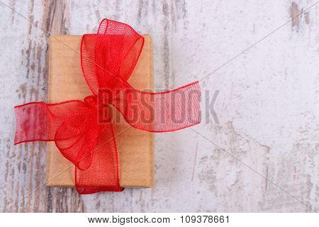 Wrapped Gift For Valentines Day On Old Wooden Table, Copy Space For Text