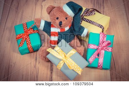 Vintage Photo, Teddy Bear With Colorful Gifts For Christmas Or Other Celebration