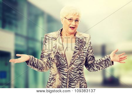 Old elegant lady having her hands spread