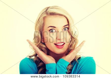 Portrait of a surprised woman with open mouth.
