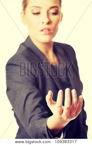 Woman holding something on her hand.