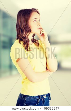 Beautiful teenage girl is thinking.