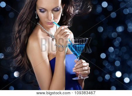 Party time. Beautiful woman with long hair holding martini glass.
