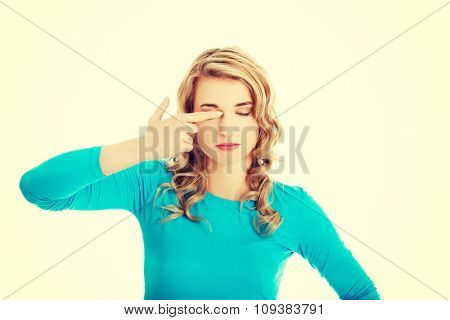 Portrait of a woman rubbing eyes.