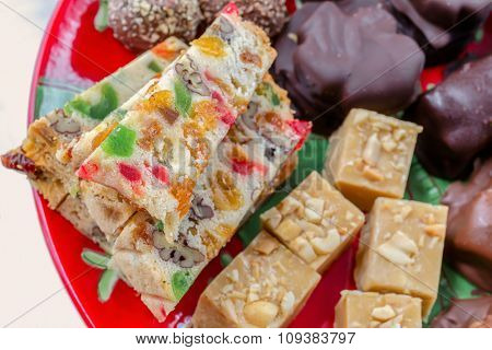 A Christmas platter full of fruitcake and other Christmas treats.