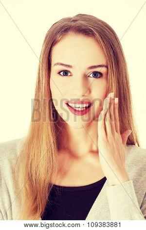 Portrait of surprised blonde woman.