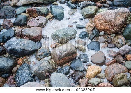 The Freezed Stones On Coast Of Baltic Sea. A Winter Landscape