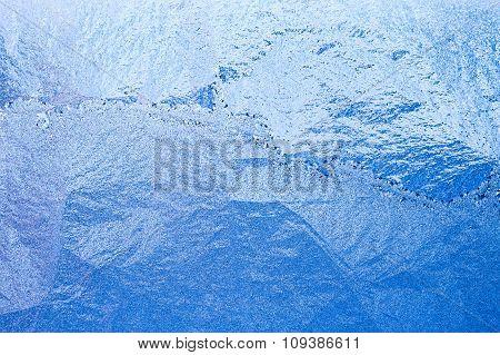 Blue frosty glass Ice background, natural pattern. Winter xmas c