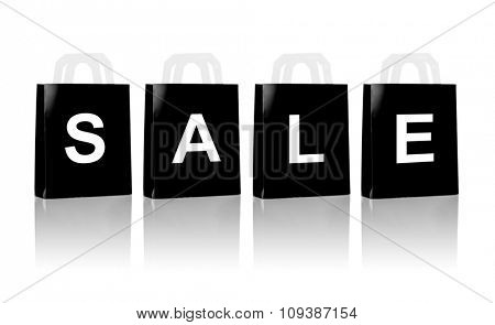 consumerism, discount, advertisement, black friday and retail concept - many black shopping bags with sale word