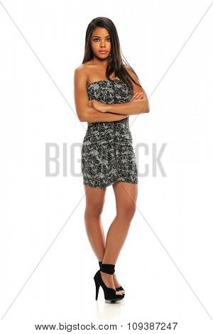 African American woman with arms crossed standing over white background