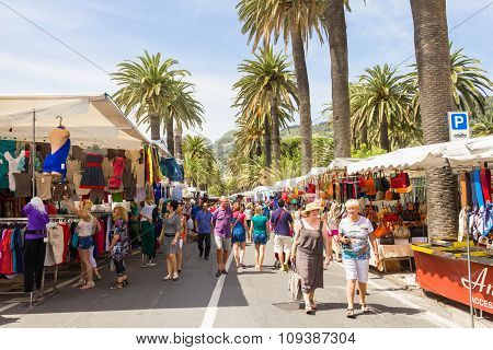 People walking on the street market in Ventimiglia, Italy