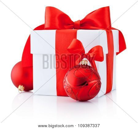 White Gift Box Tied Red Ribbon And Christmas Balls Isolated On White Background
