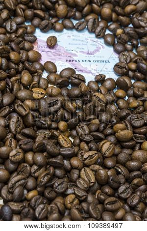 Map Of Papua New Guinea Under A Background Of Coffee Beans