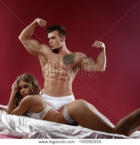 Impressive couple - strong man and sensual model