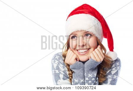 Pretty smiling girl in Santa cap
