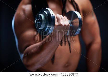 Sporty man exercising with barbell