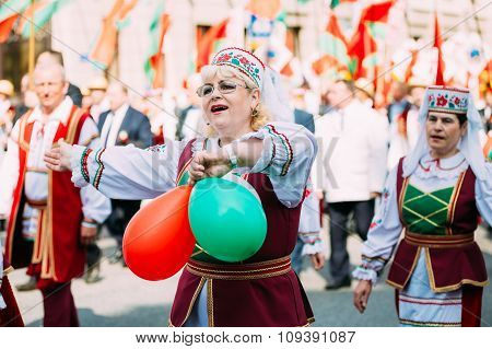 Women in national Belarusian folk costume participating in the p