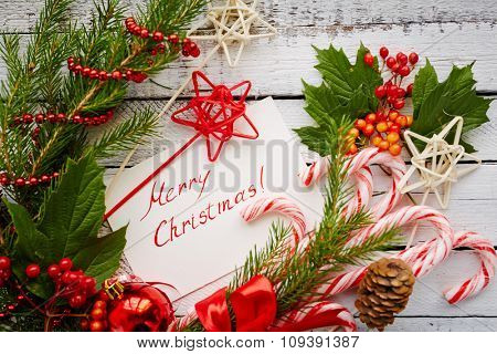 Christmas decorations, symbols and card with regards