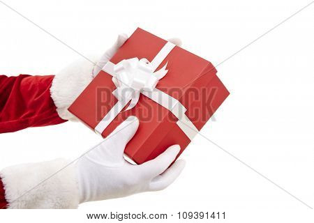 Santa Claus hands holding red package with gift