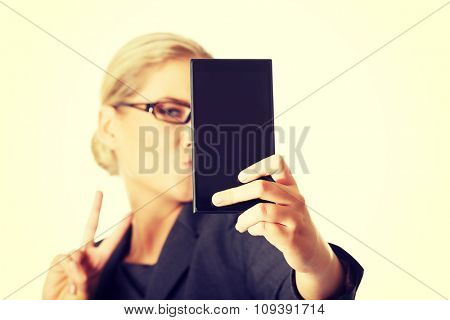 Businesswoman taking selfie with smartphone