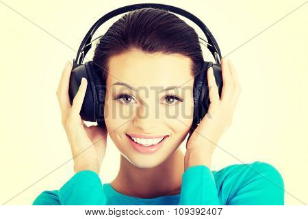 Portrait of a woman with big headphones.