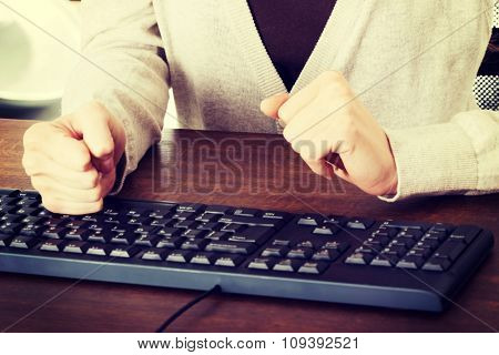 Close up woman typing on a pc keyboard.
