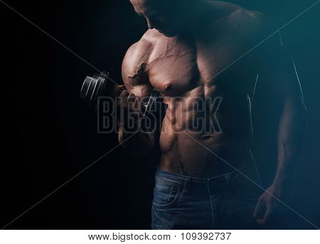 Young bodybuilder doing exercise with barbell
