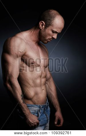 Shirtless athlete standing in isolation
