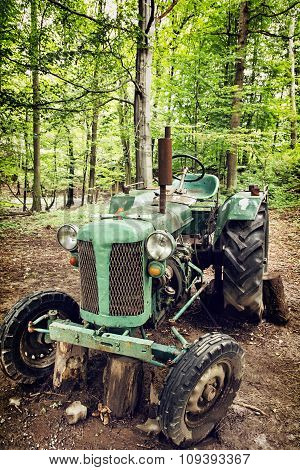 Old Broken Tractor In The Forest