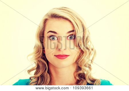 Portrait of a surprised woman with big eyes.