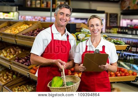 Portrait of smiling colleagues at supermarket