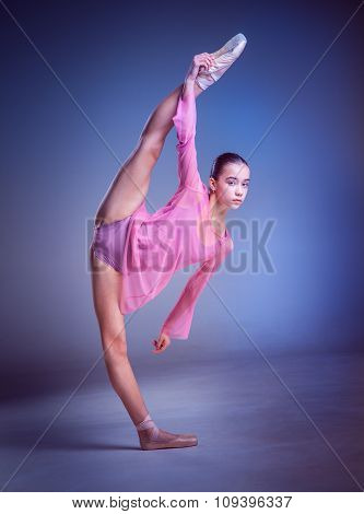 The young ballerina posing in stretching twine