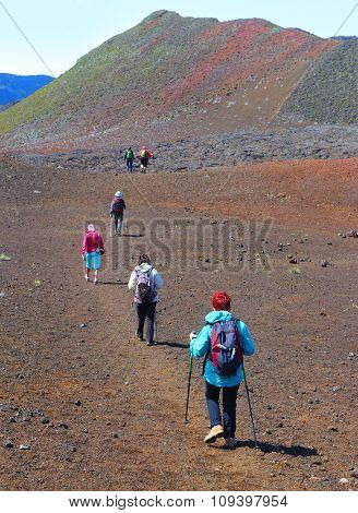 Group of hikers walking on Piton de la Fournaise (Peak of the Furnace) 2632m. Reunion island, France.