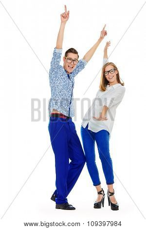 Joyful young people dancing on a party. Isolated over white. Full length portrait.