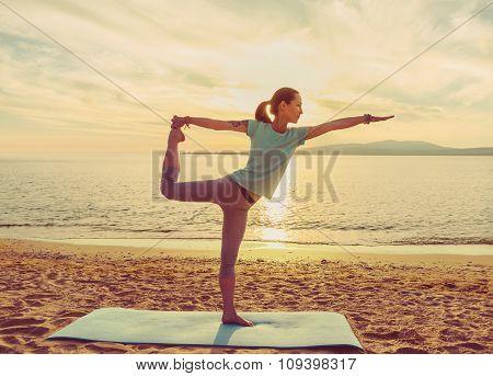Girl Practicing Yoga On Beach