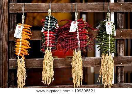 Japanese Dried Hot Chili And Rice Hang On Wood Wall