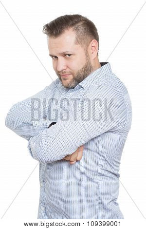 adult male with a beard. isolated on white background. Closed defensive posture. crossed arms. body