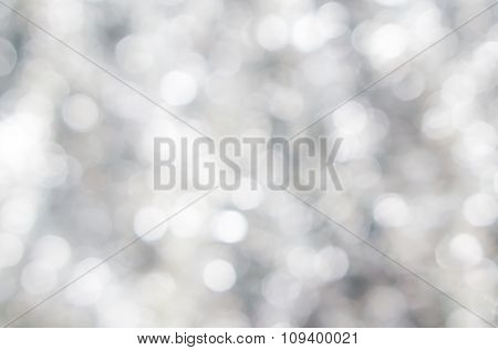 Abstract Blured Background Of Tender Silver White Shiny Christmas Tree Decorations